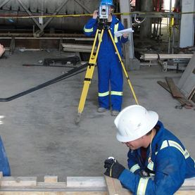 Transit Technical Services Ltd. | three workers surveying at a plant